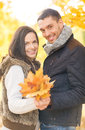 Romantic couple in the autumn park holidays love travel tourism relationship and dating concept Stock Images
