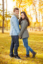 Romantic couple in the autumn park holidays love travel tourism relationship and dating concept Stock Photos