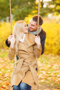 Romantic couple in the autumn park holidays love travel tourism relationship and dating concept Royalty Free Stock Images