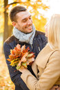 Romantic couple in the autumn park holidays love travel tourism relationship and dating concept Royalty Free Stock Photo