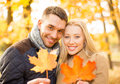 Romantic couple in the autumn park holidays love travel tourism relationship and dating concept Stock Photography