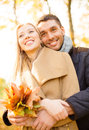 Romantic couple in the autumn park holidays love travel tourism relationship and dating concept Stock Photo