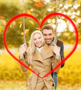 Romantic couple in the autumn park holidays love travel tourism relationship and dating concept Royalty Free Stock Image