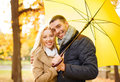 Romantic couple in the autumn park holidays love travel tourism relationship and dating concept with umbrella Stock Image