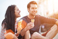 Romantic couple eating ice cream at park photo of a sunset Stock Image