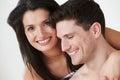 Romantic couple embracing against white studio background smiling Stock Image