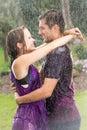 Romantic couple embracing in rain Royalty Free Stock Photo