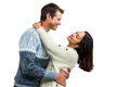 Romantic couple embracing in warm clothing against white background Stock Image