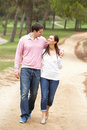 Romantic couple enjoying walk in park Royalty Free Stock Image