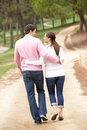 Romantic couple enjoying walk in park Stock Images