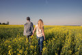 Romantic couple in a field of yellow flowers Royalty Free Stock Photo
