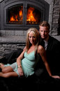 Romantic couple fireplace roaring Royalty Free Stock Image