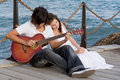 romantic couple with guitar Royalty Free Stock Photo