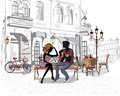 Romantic couple with a guitar sitting on the bench in the old city Royalty Free Stock Photo