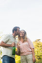 Romantic couple having champagne together outside in sunshine Royalty Free Stock Photo