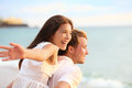 Romantic couple having fun on beach honeymoon travel vacation summer holidays romance young happy lovers asian women and Stock Image