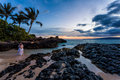 Romantic couple hawaii beach sunset young embrace on a at on maui Stock Photography