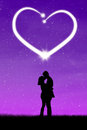 Romantic couple with heart silhouette of on the purple background Royalty Free Stock Photography