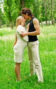 Romantic couple kissing Stock Images