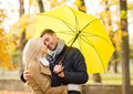 Romantic couple kissing in the autumn park holidays love travel tourism relationship and dating concept Stock Images