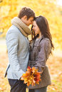 Romantic couple kissing in the autumn park holidays love travel tourism relationship and dating concept Royalty Free Stock Images
