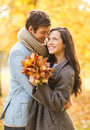 Romantic couple kissing in the autumn park holidays love travel tourism relationship and dating concept Royalty Free Stock Photos