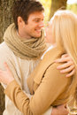Romantic couple kissing in the autumn park holidays love travel tourism relationship and dating concept Royalty Free Stock Photography