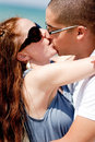 Romantic Couple kissing on the beach Royalty Free Stock Photos