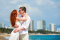Romantic couple kissing on the beach attractive boy and girl posing and a Royalty Free Stock Photo