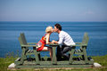Romantic couple kissing and holding hands on the bench Royalty Free Stock Image