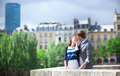 Romantic couple is kissing in Paris at the bridge Stock Images