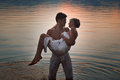 Romantic couple in lake waters Royalty Free Stock Photo