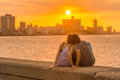Romantic couple looking at a sunset in Havana Royalty Free Stock Photo