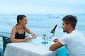 Romantic Couple In Love Having Dinner At Sea Beach Restaurant Royalty Free Stock Photo