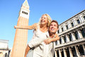 Romantic couple in love having fun in venice embracing and laughing doing piggyback ride italy on piazza san marco happy young Royalty Free Stock Photos