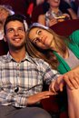 Romantic couple at movie theater watching in cinema smiling Royalty Free Stock Image