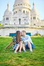 Romantic couple near Sacre-Coeur cathedral on Montmartre, Paris Royalty Free Stock Photo