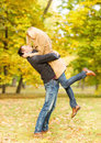Romantic couple playing in the autumn park holidays love travel tourism relationship and dating concept Royalty Free Stock Photos