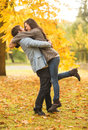 Romantic couple playing in the autumn park holidays love travel tourism relationship and dating concept Stock Photos