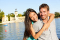 Romantic couple portrait embracing in love looking at camera multiracial women and men smiling happy by lake el retiro Royalty Free Stock Photography
