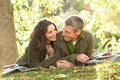 Romantic Couple Relaxing Outdoors In Autumn Royalty Free Stock Photo