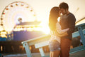 Romantic couple at santa monica sunset kissing in front of ferris wheel Stock Photography