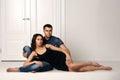 Romantic couple sitting on floor Royalty Free Stock Photo