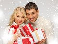 Romantic couple in a sweaters with gift boxes picture of Stock Image