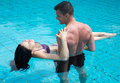 Romantic couple at swimming pool young attractive in love in the water Stock Photos