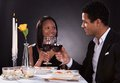 Romantic couple toasting red wine portrait of at dinner Royalty Free Stock Photography