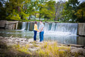 Romantic Couple by Waterfall Royalty Free Stock Photo
