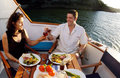 Romantic couple on a yacht kerikeri nz dec having dinner dec the marriage rates in nz have fallen in the past years and Royalty Free Stock Image