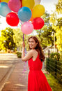 Romantic date aniversary street walking female with bunch of colorful Royalty Free Stock Photography