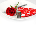 Romantic diner a table setting with rose on a white background close up Royalty Free Stock Photography